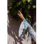 Голубой комбинезон шортами в листья