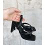 Черные шлепанцы на плоских каблуках Италия