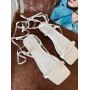 Белые сандалии на завязках без каблуков Италия