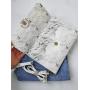 Белый клатч с мраморным принтом
