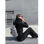 Черный костюм с широкими брюками с прорезью